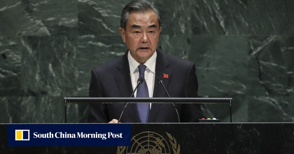 """Chinese Foreign Minister Wang Yi warns that the world """"must come together more than ever"""""""
