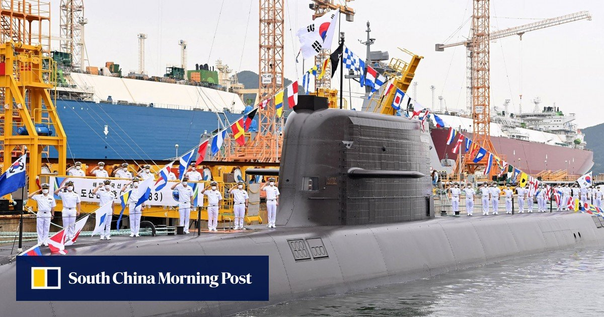South Korea fires a ballistic missile down from submarines for the first time while the North prepares for the military parade