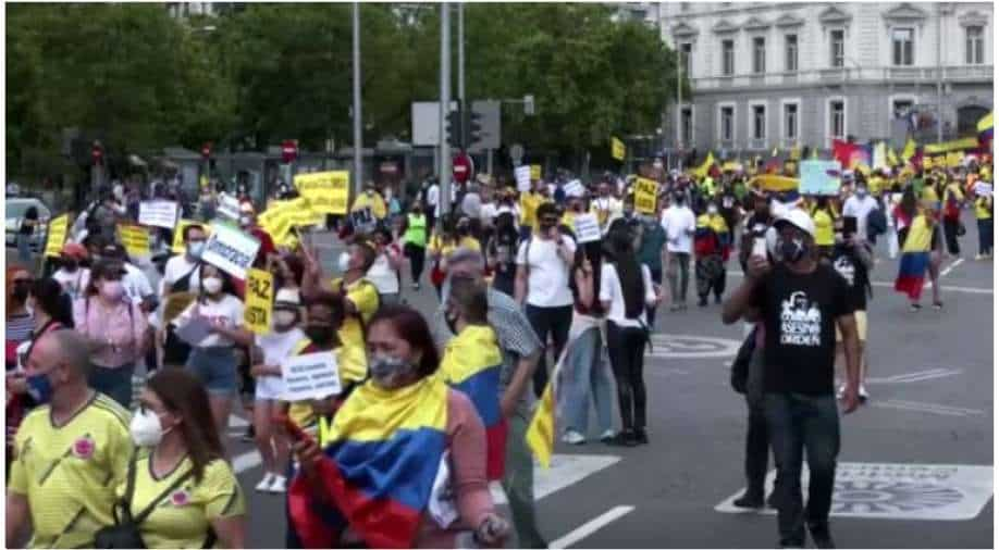 Colombians march in Madrid to support protests in their homeland