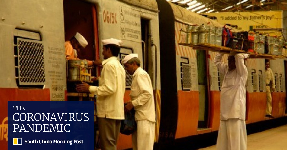 """""""Our job is at stake"""": Mumbai's """"Dabbawallas"""" fear for their future as the coronavirus closes the age-old network for the delivery of food"""