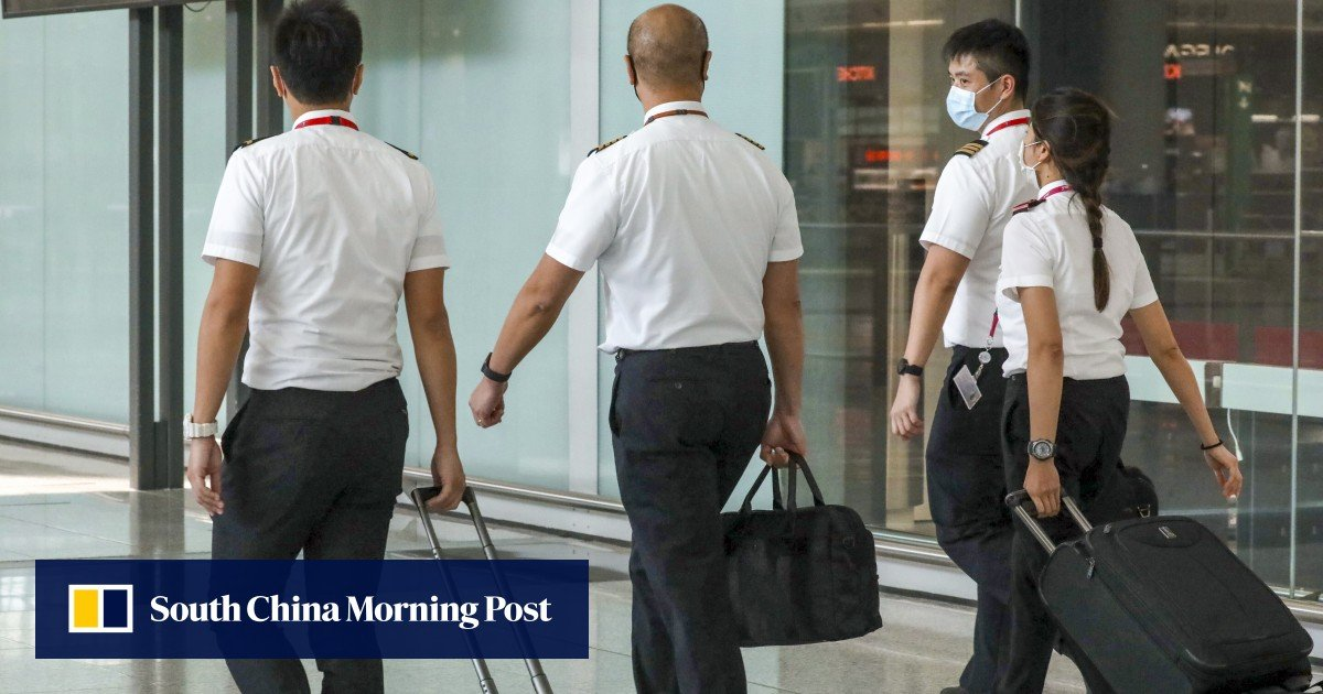 Hong Kong is denying work visas to dozen of Cathay Pacific pilots planning to move to the city