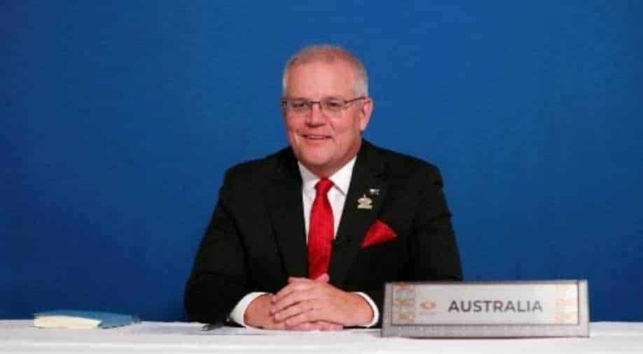 Australia relaxes international border restrictions from November